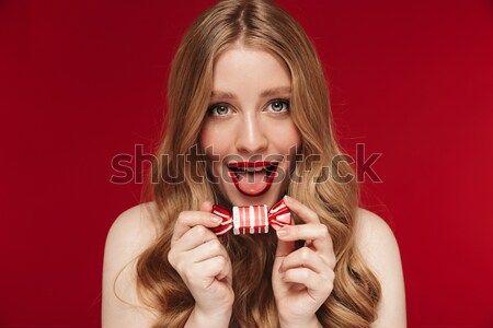 Portrait of a delighted brown haired woman Stock photo © deandrobot