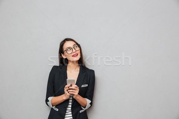Dalgın gülen Asya iş kadını gözlük Stok fotoğraf © deandrobot