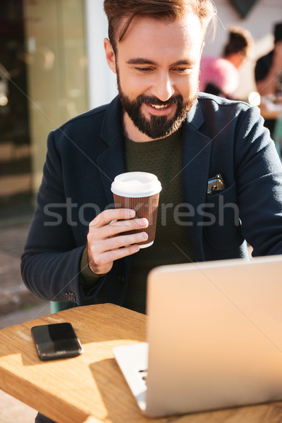 Portrait of a young attractive man working on laptop Stock photo © deandrobot