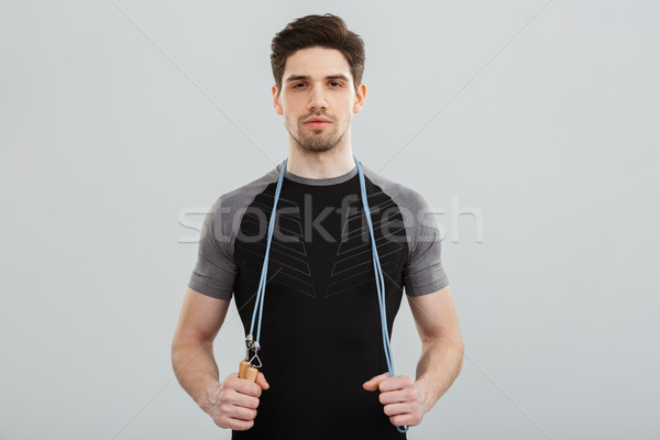 Portrait concentré jeunes corde isolé Photo stock © deandrobot