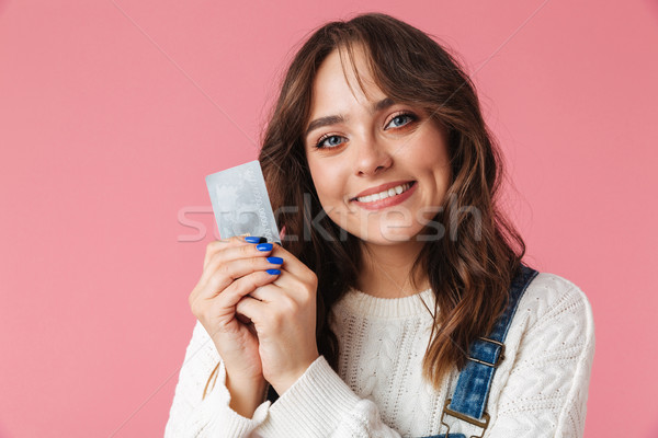 Portrait of a satisfied young girl holding credit card Stock photo © deandrobot