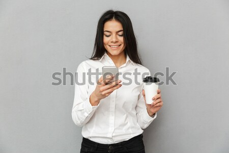 Photo of attractive business woman in formal wear holding mobile Stock photo © deandrobot