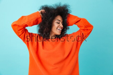 Colorful portrait of american woman in casual wear looking aside Stock photo © deandrobot