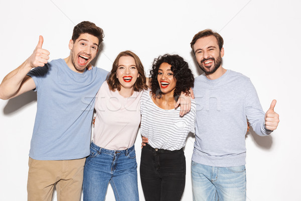 Stock photo: Group of happy multiracial people showing thumbs up