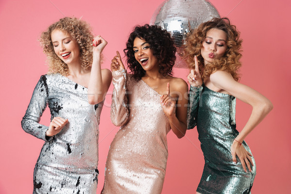 Stock photo: Three beautiful cheerful women in shiny dresses
