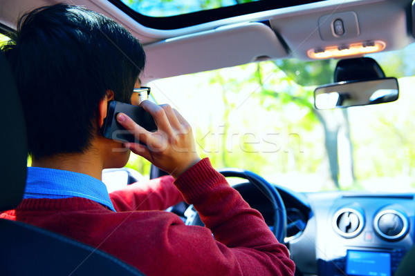 Hátulnézet portré fiatalember beszél telefon vezetés Stock fotó © deandrobot