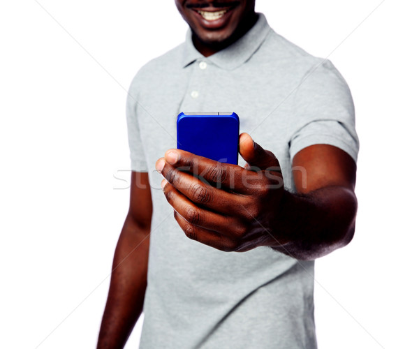 Closeup portrait of a male hands holding smartphone isolated on white background Stock photo © deandrobot