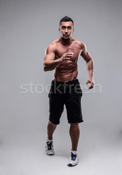 Portré izmos férfi fut szürke sport Stock fotó © deandrobot