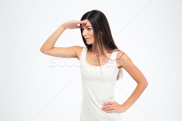 Nő néz távolság gyönyörű nő izolált fehér Stock fotó © deandrobot