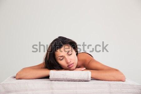 Woman lying on massage lounger in a wellness center  Stock photo © deandrobot