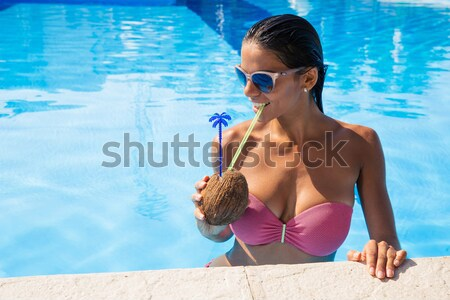 Pretty woman applying sun cream  Stock photo © deandrobot