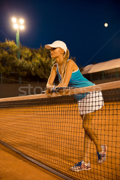 Full length portrait of a beautiful female tennis player  Stock photo © deandrobot