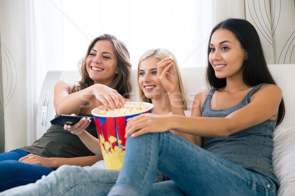 три счастливым еды попкорн смотрят Сток-фото © deandrobot