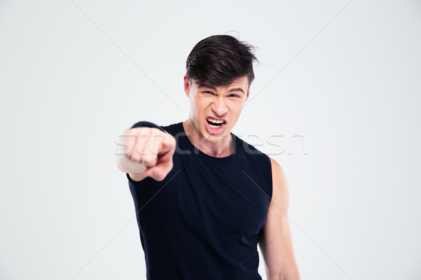 Angry fitness man pointing finger at camera Stock photo © deandrobot
