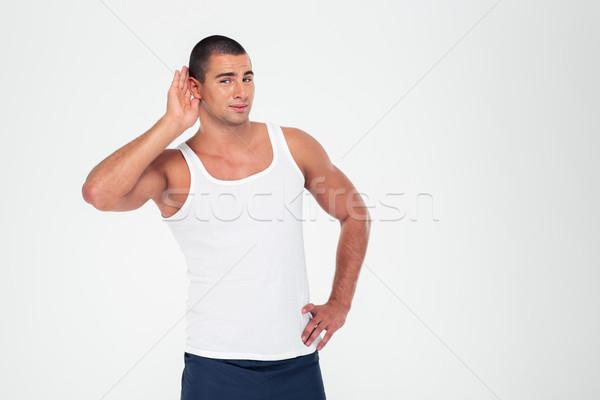 Man hand oor luisteren iets Stockfoto © deandrobot