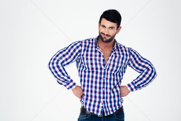 Portrait of a handsome macho  Stock photo © deandrobot