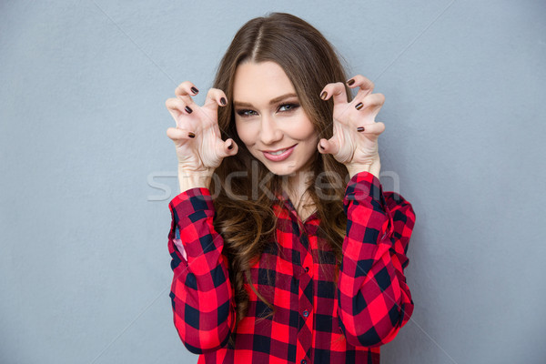 Stock photo: Woman reading for scratch with nails