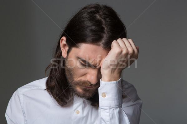 Portrait of a young upset man  Stock photo © deandrobot