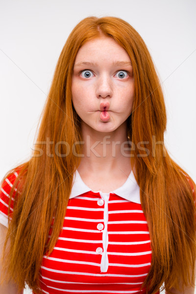 Funny redhead girl fooling aroung and making funny faces Stock photo © deandrobot