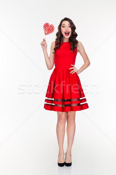 Mutlu kadın kırmızı elbise kalp Stok fotoğraf © deandrobot