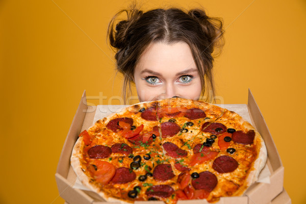Lovely cute positive young woman hiding behind pizza Stock photo © deandrobot