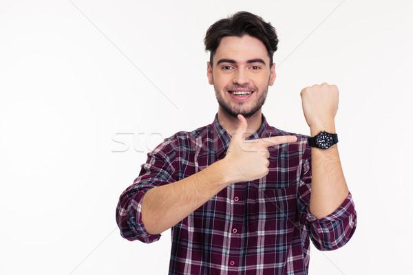 Mosolyog férfi mutat ujj karóra portré Stock fotó © deandrobot