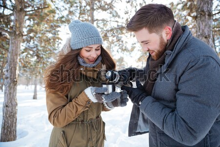 Man making photo of his girlfriend outdoors Stock photo © deandrobot