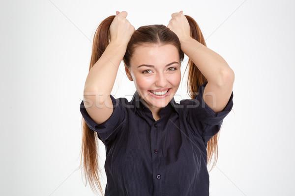 Derűs gyönyörű fiatal nő készít kettő kezek Stock fotó © deandrobot