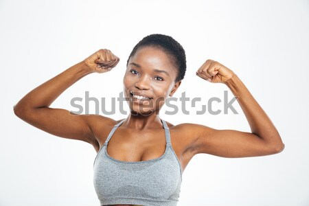 Souriant afro femme biceps Photo stock © deandrobot