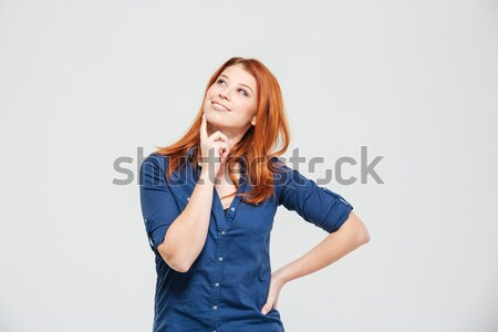 Happy beautiful thoughtful redhead young woman standing and dreaming Stock photo © deandrobot