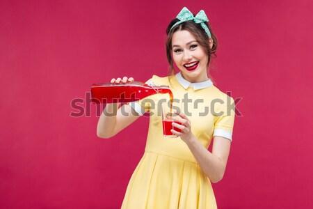 Gülen çekici genç kadın ayakta renkli Stok fotoğraf © deandrobot