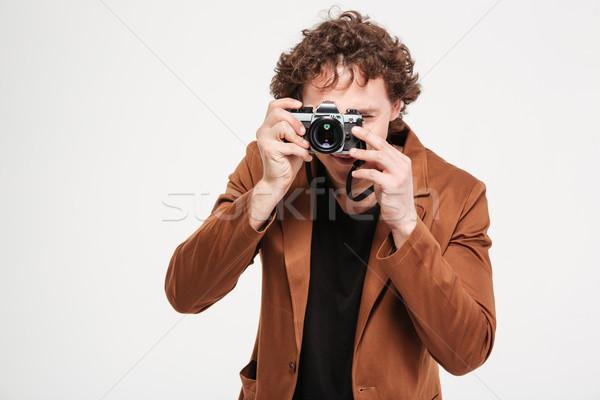 Man photographing on retro camera  Stock photo © deandrobot