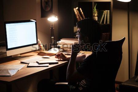 Dalgın adam çalışma bilgisayar düşünme akşam Stok fotoğraf © deandrobot