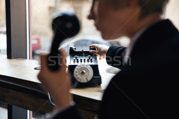 Cropped image of young beautiful woman with telephone Stock photo © deandrobot