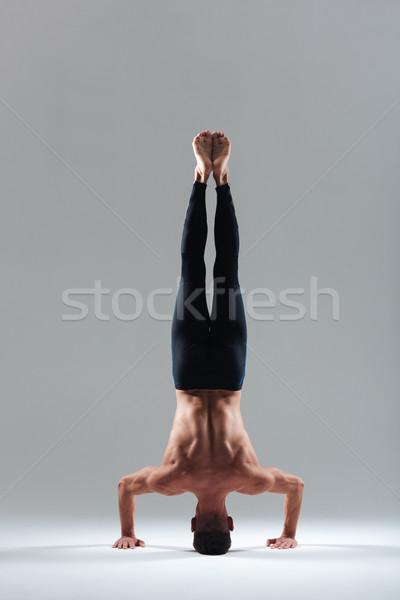 Man doing headstand Stock photo © deandrobot