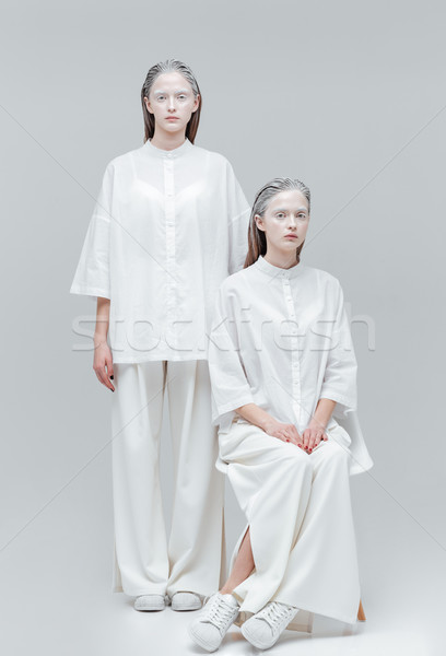 Two beautiful mystical women in white dress Stock photo © deandrobot