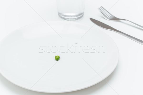 пластина один небольшой зеленый служивший таблице Сток-фото © deandrobot