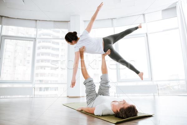 Csinos fiatal nő gyakorol jóga partner stúdió Stock fotó © deandrobot