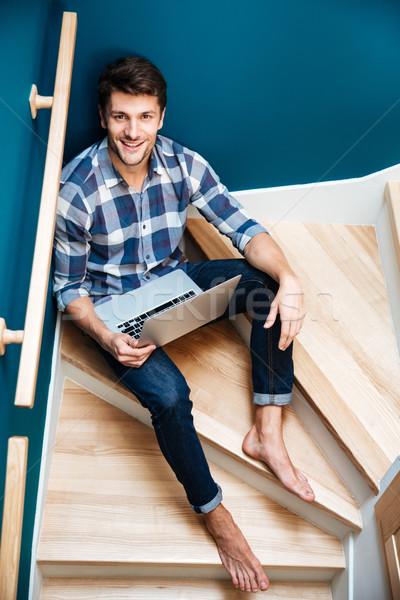 человека сидят лестницы домой используя ноутбук Сток-фото © deandrobot