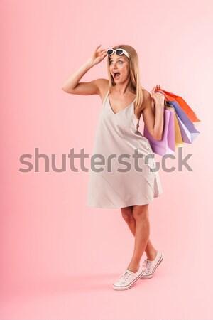 Jonge mooie vrouw Geel matras zwemmen geïsoleerd Stockfoto © deandrobot