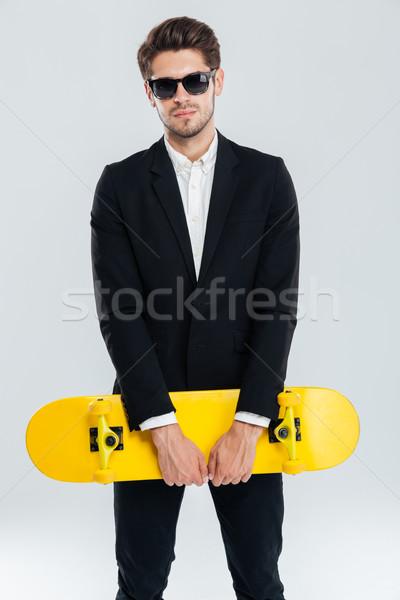 çekici genç işadamı siyah takım elbise sarı Stok fotoğraf © deandrobot