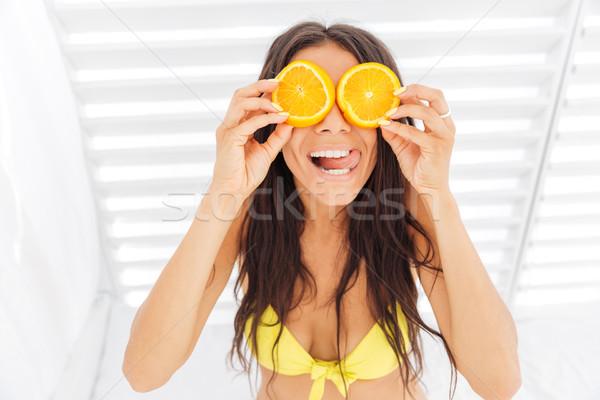 Donna bikini due arancione occhi Foto d'archivio © deandrobot