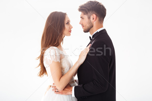 Image of pretty newlyweds Stock photo © deandrobot