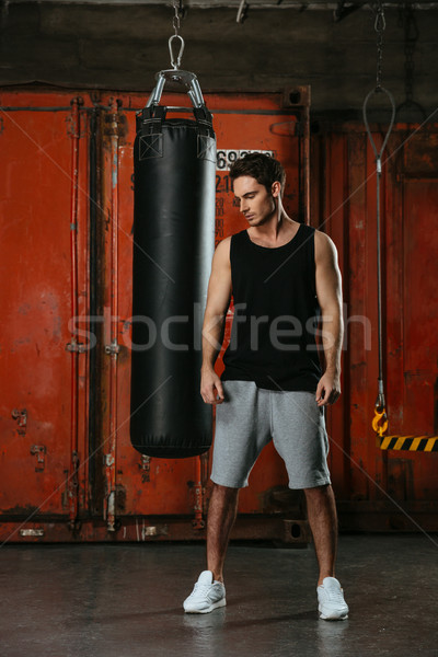 Handsome young strong boxer training in a gym Stock photo © deandrobot