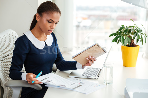 Stock photo: African business woman with laptop and documents