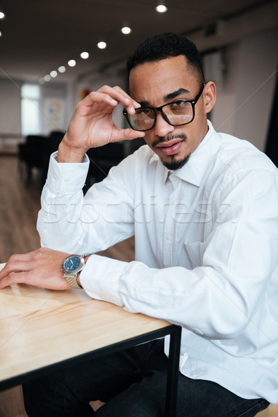Serious african businessman coworking. Stock photo © deandrobot