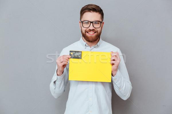 Jóképű üzletember tart copy space debitkártya kép Stock fotó © deandrobot