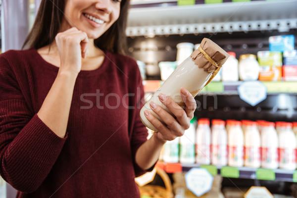 Mutlu kadın satın alma yoğurt bakkal Stok fotoğraf © deandrobot