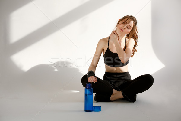 Serious young sports lady boxer sitting with bottle water Stock photo © deandrobot