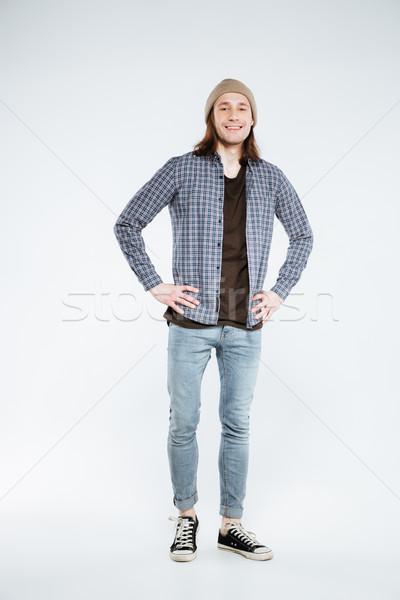 Pionowy obraz uśmiechnięty broni biodro Zdjęcia stock © deandrobot